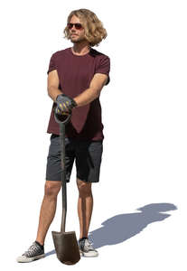 man with a spade standing