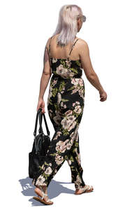 woman in a flower print jumpsuit walking