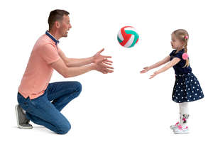 father and daughter playing with a ball