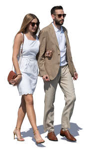man and woman in fancy summer outfits walking