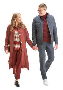 young couple walking happily hand in hand