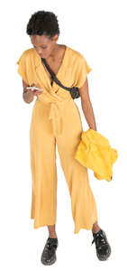 woman in a yellow jumpsuit standing