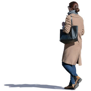 woman in a beige coat walking