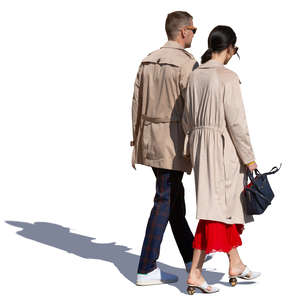 couple in brown overcoats walking