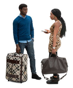 man and woman with travel bags standing and talking