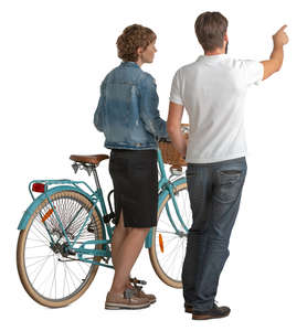 man and woman standing with a bicycle and looking at smth