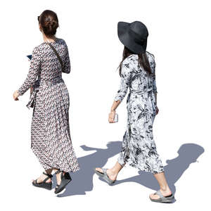 two women in summer dresses walking seen from above