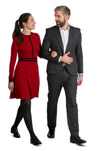 couple in formal clothes walking arm in arm