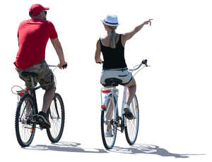 backlit man and woman biking