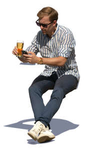 man sitting and drinking beer on a sunny day