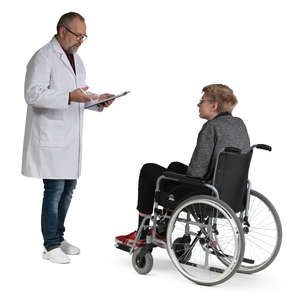 doctor talking to a young man in a wheel chair