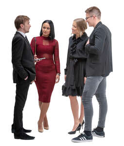 four people standing and talking