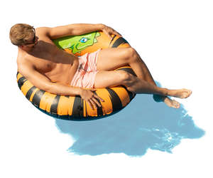 man sunbathing in a large swim ring