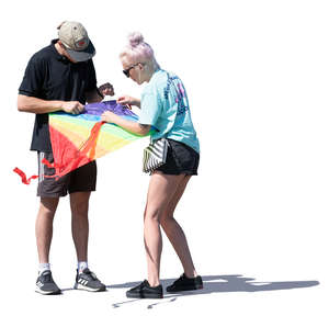 two people preparing to fly a kite