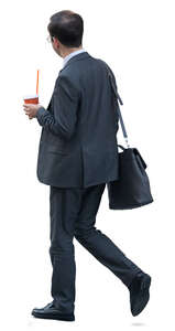 asian businessman with a coffee cup walking