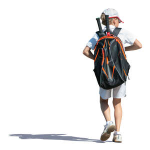 little boy with a tennis bag walking