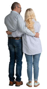 elderly couple standing with arms around each other