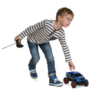 little boy playing with a toy car