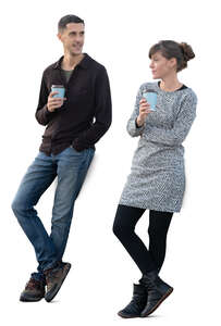 man and woman standing and drinking coffee