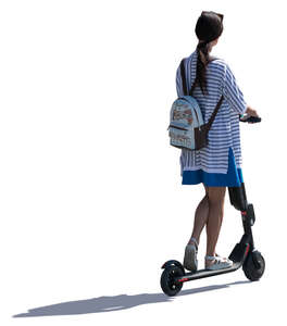 young backlit woman riding an electrical scooter