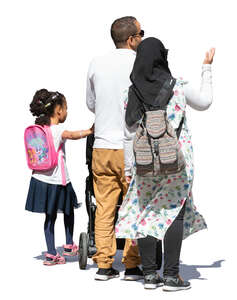 muslim family of three standing