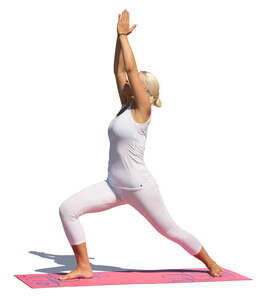 woman in a white sports outfit doing yoga
