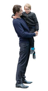 man standing and holding his son