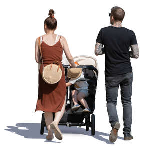 family with a child in a stroller walking