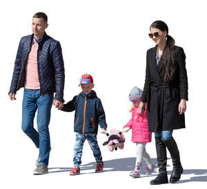 family with two children walking hand in hand