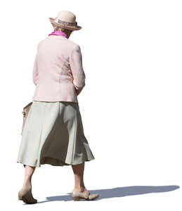 elderly woman with a hat walking