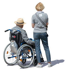 elderly couple with a man in a wheel chair