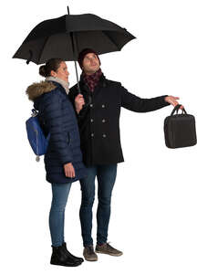 man and woman standing under the umbrella