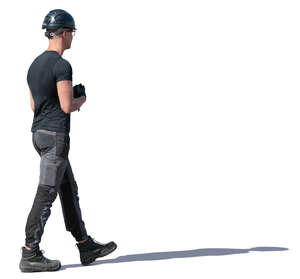 worker with a helmet walking