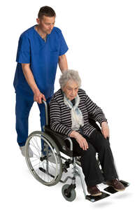male nurse pushing an elderly lady in a wheel chair