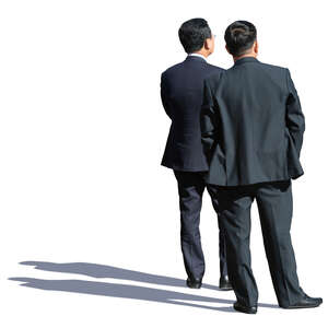 two asian businessmen standing and looking in one direction