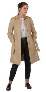 woman in a trenchcoat standing