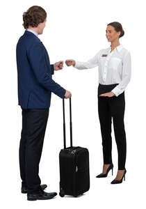hotel receptionist talking to a businessman