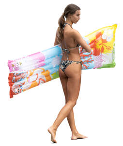 woman with a swim mattress walking