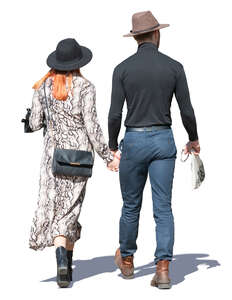 couple with hats walking hand in hand