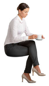 woman sitting and having a cup of coffee