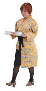asian waitress bringing tea