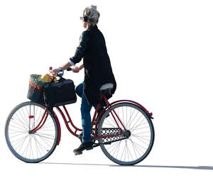 sidelit woman riding a bike
