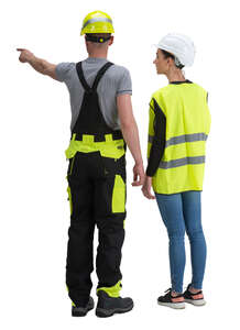 man and woman with helmets standing on construction site