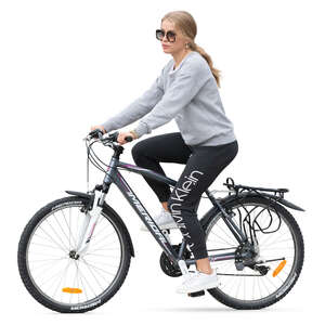 woman in sports outfit riding a bike