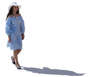 backlit woman with a summer hat walking