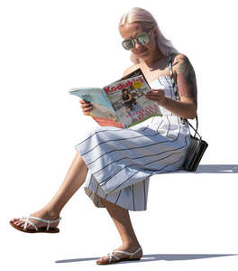 woman reading a magazine on a sunny day