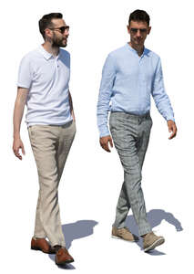 two men walking and talking on a summer day