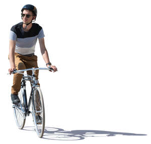 young man with a helmet riding a bike