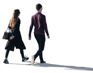 two young people walking with backlit light