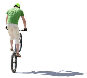 young man doing a stunt on a bike
